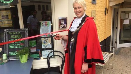 Bungay mayor Mary Matthews launching the new menu at the Fisher Theatre's Limelight Café during an e