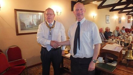Michael Ingram, left, being installed by Jonathan Watts as Bungay Rotary Club's new president. Pictu