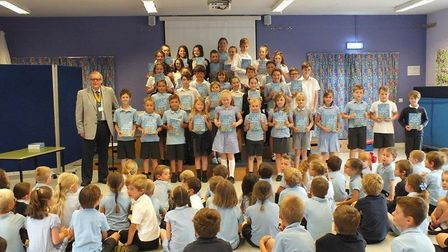 Children at Ellingham Primary School receiving their dictionaries. Picture: Colin Bale.