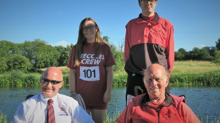 Competitors Rebecca Sillis and Andrew Todd stand behind Committee member and British Rowing Official