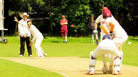 Norfolk player James Hale delivers for Great Witchingham during Saturday's clash with EAPL leaders S