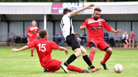 A midfield tussles as local rivals Beccles and Bungay go head to head. Picture: Nick Butcher
