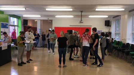 Students at Sir John Leman High School Sixth Form collect their results. Photo: James Carr.