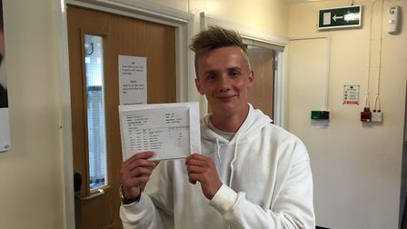 Jordan Wright, of Bungay High School Sixth Form, collects his results. Photo: James Carr.