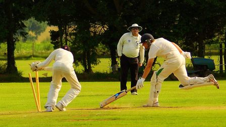 Great Witchingham opener James Spelman just survives a run-out attempt at Halvergate. Picture: Tim F