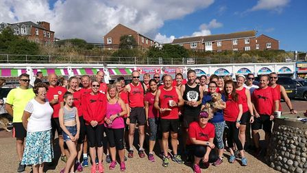 Members of Bungay Black Dogs Running Club turned out in force to support Alice Kirk on her 200th par