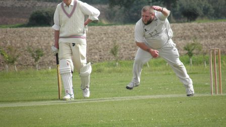 Hales and Loddon's Will Yates attempts to make a breakthrough under the watchful eye of club preside