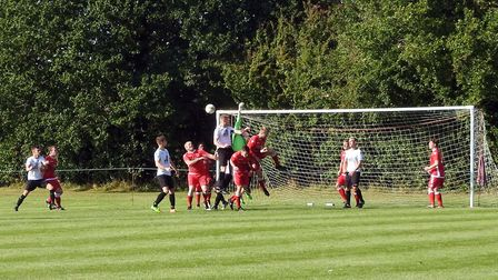 Jon Lovelock, aided by Lee Glover and Billy Shaw, pile on the pressure for Beccles at Reepham. Pictu