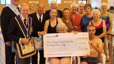 Members of the Lodge of Prudence, Halesworth Freemasons, mark their 300th anniversary with the prese