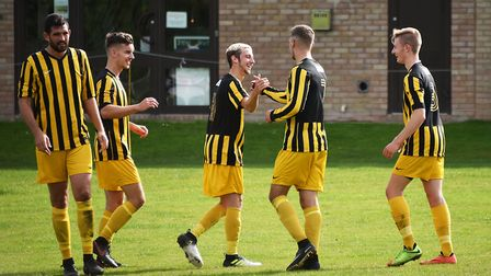 Beccles celebrate their third goal against Acle in a match which ended all square at 3-3. Picture: A