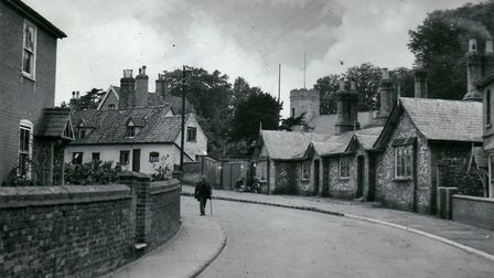 Corner of Staithe Road in Bungay, with Dreyer's Homes & Parish Church of Holy Trinity in the backgro