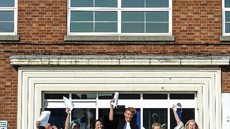 Beccles Free School students leap for joy after recieving their GCSE results. Photo: Simon Lee, Seck