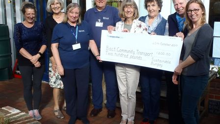 Sustainable Bungay presented BACT with a cheque at the Bungay Library garden. Picture: Courtesy of R