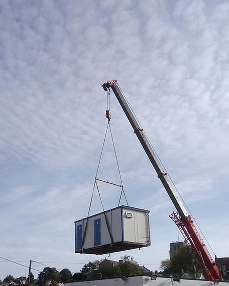 The old toilets being lifted out by a crane at Beccles Lido. Picture: Carl Murray.