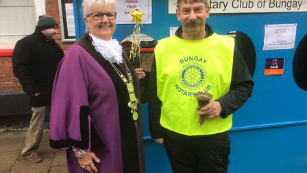 Bungay town reeve Mary Sprake and Rotarian Vaughan Shea at the human fruit machine at the Christmas