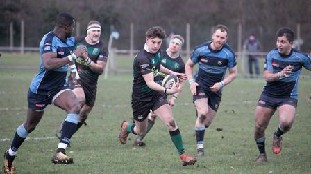 North Walsham apply some pressure during a tough game at Eton Manor on Saturday which saw them slide