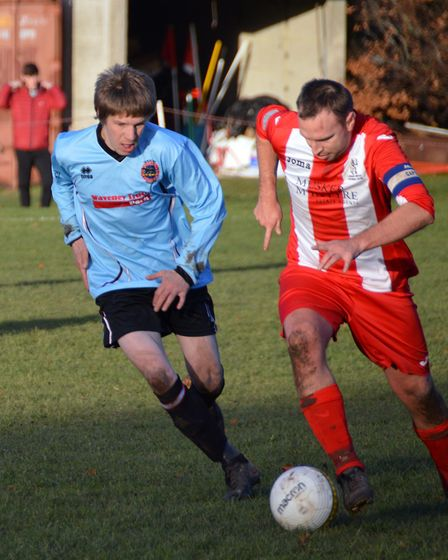 Bungay Town's Kev Riches in action against Loddon.Picture: Shaun Cole