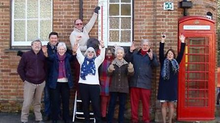 Members of the Geldeston Village Hall community celebrate receiving £46,240.00 grant funding from WR