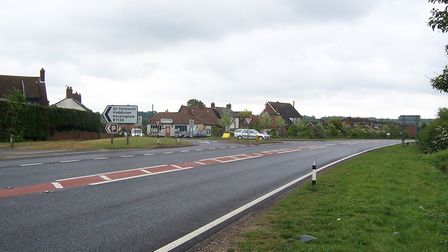 The T-junction of the A146 and B1136 at Hales from the north