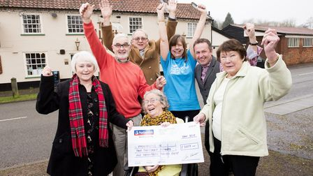 Vickie Cunnane (centre) with a cheque for over £2,000 for Parkinson's UK, which was raised at The Wh