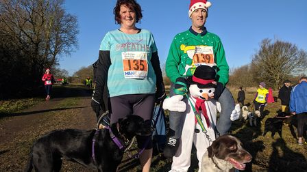 Kathryn Moore from Morningthorpe with lab cross Amy and Kevin Keeler from Hempnall with 'sprollie' D