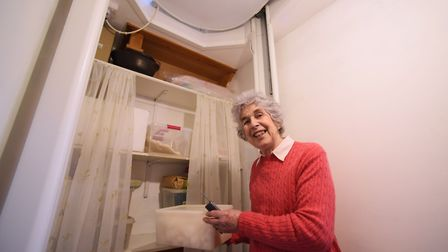 Jane Seppings in the lift space with the lift tucked up on the upper floor as she gathers food from