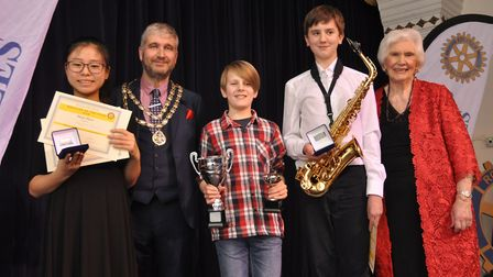 Young musicians Polly Chan, Gwilym Howarth and Stuart Taylor, with mayor Richard Stubbings and Rotar
