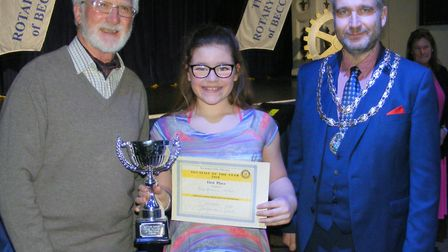First place vocalist Rosie Ashdown-Nichol, pictured with Rotarian Paul Randle and mayor Richard Stub