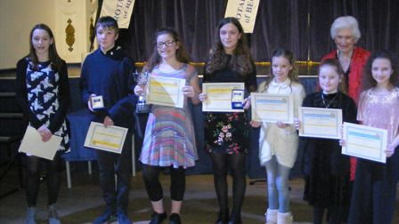 The performers in the Young Vocalist of the Year competition, with Rotarian Colleen Simpson. Picture