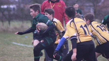 Beccles Rugby Club's Under-13s in action against their West Norfolk counterparts (see back page). Pi