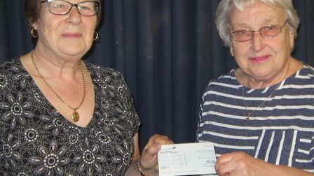 Brenda Clarke presenting a cheque for £1,000 to Maureen Saunders, secretary of Beccles Hospital's Le