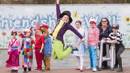 Worlingham Primary School pupil Isaac Caswell-Jones jumps for joy dressed as Willy Wonka during Worl