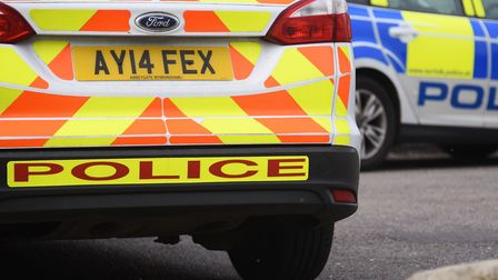 Unmarked and marked police cars were seen in Beccles. Picture: Denise Bradley