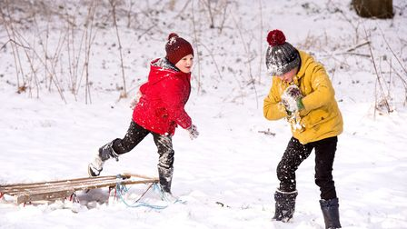 Charlie (yellow) and Isaac Bullion from Beccles enjoy the snow before school.Picture: Nick Butcher