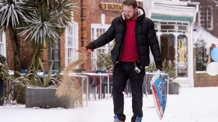 Sean Lane from QD store clearing the snow from the pavement.Picture: Nick Butcher