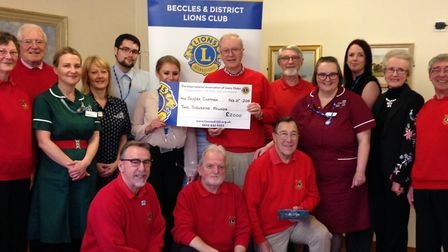 Beccles and Districts Lions Club present the cheque to the Sandra Chapman Centre at James Paget Univ