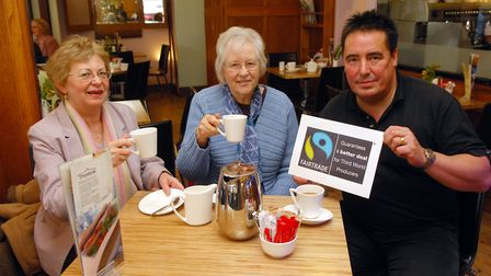 Wendy Moxon, centre, with Brenda Sigsworth and Richard Godfrey from Tywfords when the town was award