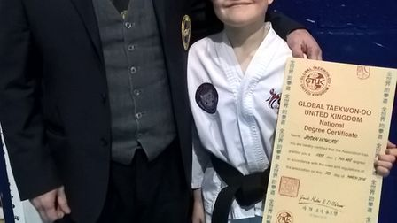 Jayden Howgate received his black belt in Coventry. Picture: Clint Gillett