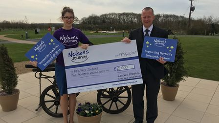 Richard Houston, manager of Waveney Memorial Park and Crematorium, presents a cheque for £5,000 to G