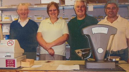 Ray Bartram, owner of Bartram's pet food store, with his daughter Gillian, son Nigel and son-in-law