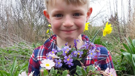 Rowan Potterton with a selection of traditional primulas ahead of the plant fair at Earsham Wetland