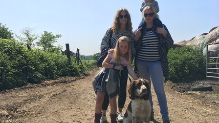 Rosie Downing (top) with Amy Debenham, Sam Downing (middle), Daisy Downing (bottom) and their dog, S