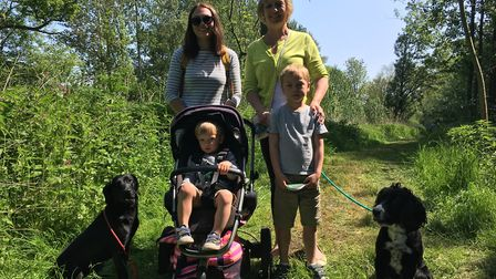 Michelle Foot and Karen Bedingfield with Ezra, Jack, and their dogs, Bee and Sid. Picture: Thomas Ch