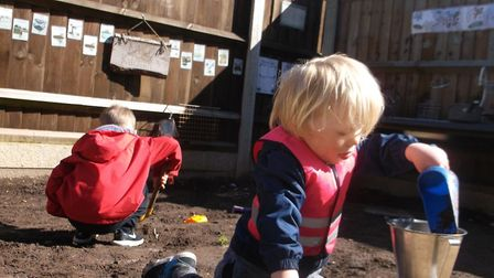 Reggie Button and Hendrix Nunn having fun in the Mud Kitchen. Pictures: Courtesy of East Coast Commu
