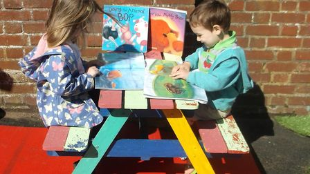 Rose Peck and Kael King in the garden's new reading corner. Pictures: Courtesy of East Coast Communi
