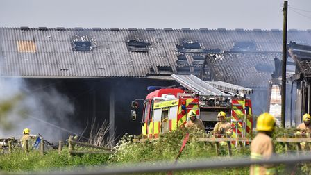 Fire crew tackle a large blaze at Great Common Farm, Ilketshall St Andrew near Bungay.Picture: Nick