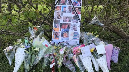 Floral tributes and photos laid at the scene of the crash in Aldeby in memory of Daniel Blowers. Pic