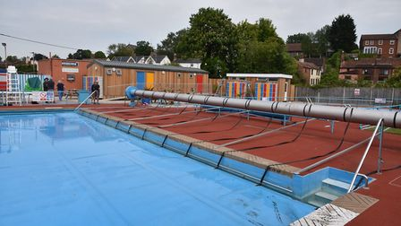 Volunteers at Beccles Lido work to get the pool ready for opening tomorrow. Picture: Sonya Duncan.