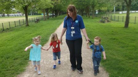 Grace Goodrum, Declyn Cassidy and Joshua Williams step out on their Wiggle Walk with Big Sky's Rache