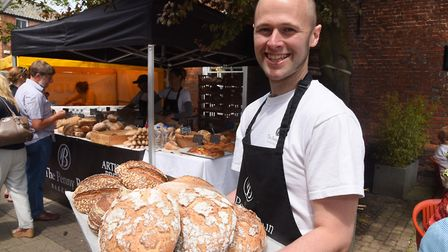 Johnny Spillings, owner of the Penny Bun Bakehouse, with some of the varieties of bread he has at th